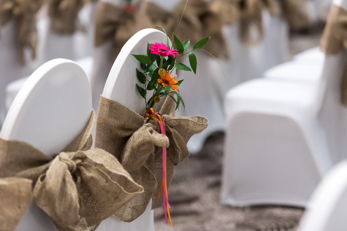 chair covers, brown fabric, flowers tied in